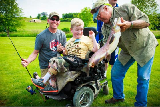 Bill Engber helps a young man catch the fish of a lifetime!